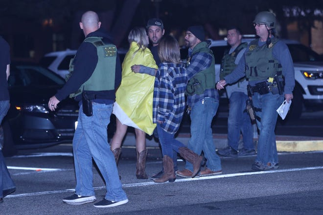 People comfort each other at the scene of a mass shooting at the Borderline Bar and Grill in Thousand Oaks, Calif., on Nov. 8, 2018.
