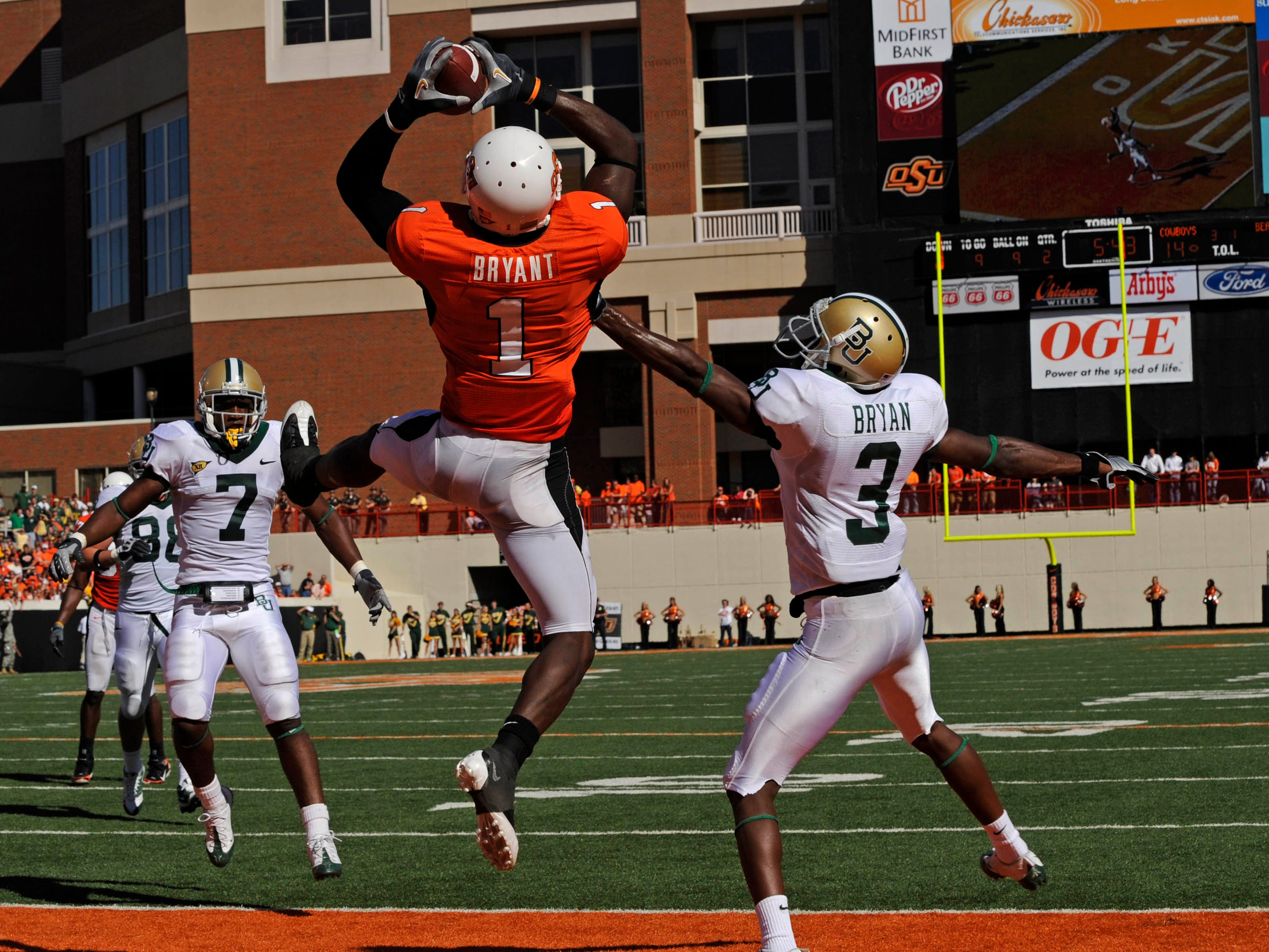 Dez Bryant pulls in a 9-yard touchdown pass against Baylor during a 2008 game at Boone Pickens Stadium.