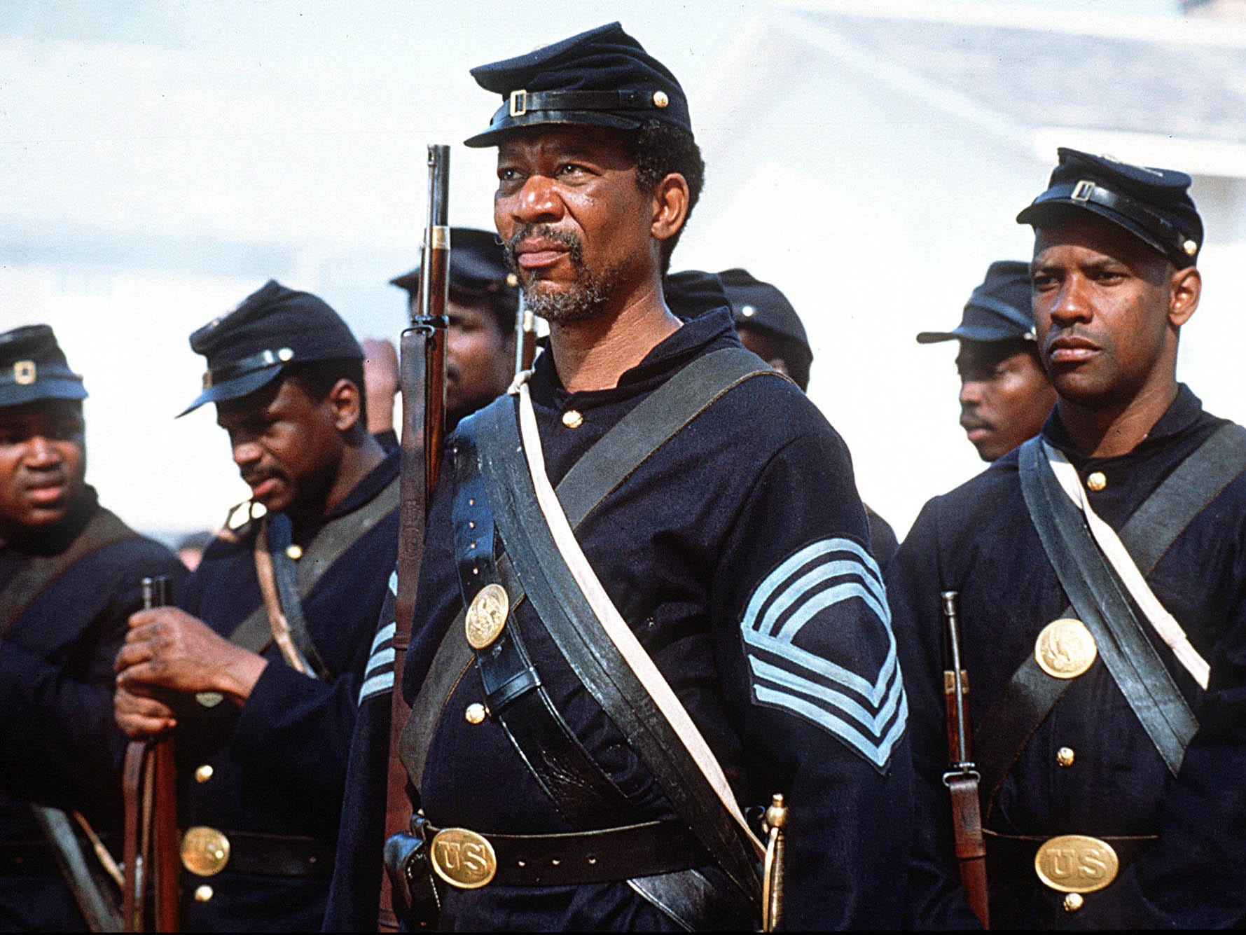 "BLACKHISTORY-DVDS -- Morgan Freeman, center, and Denzel Washington, right, appear in a scene from the motion picture ""Glory."" (Gannett News Service, Merrick Morton/Tri-Star Pictures/File) ORG XMIT: GNS [Via MerlinFTP Drop]"