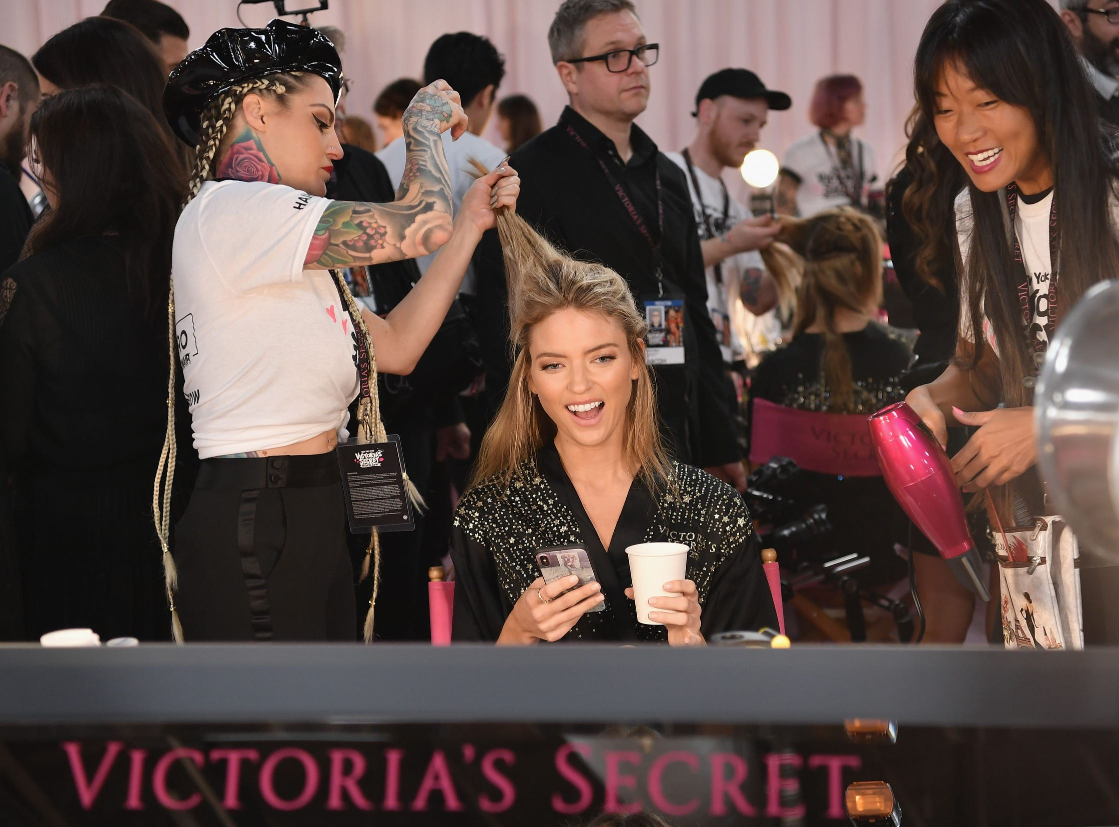 Martha Hunt has her tresses styled backstage, Thursday.