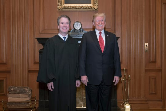 President Donald Trump and Associate Justice Brett M. Kavanaugh pose in the Justices' Conference Room before an investiture ceremony at the Supreme Court on Nov. 8, 2018, in Washington, D.C.