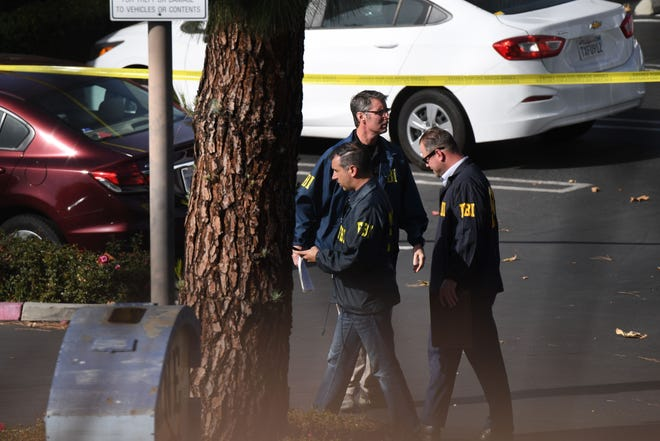 Investigators work at the scene of a mass shooting at the Borderline Bar & Grill in Thousand Oaks, California, Nov. 8, 2018.