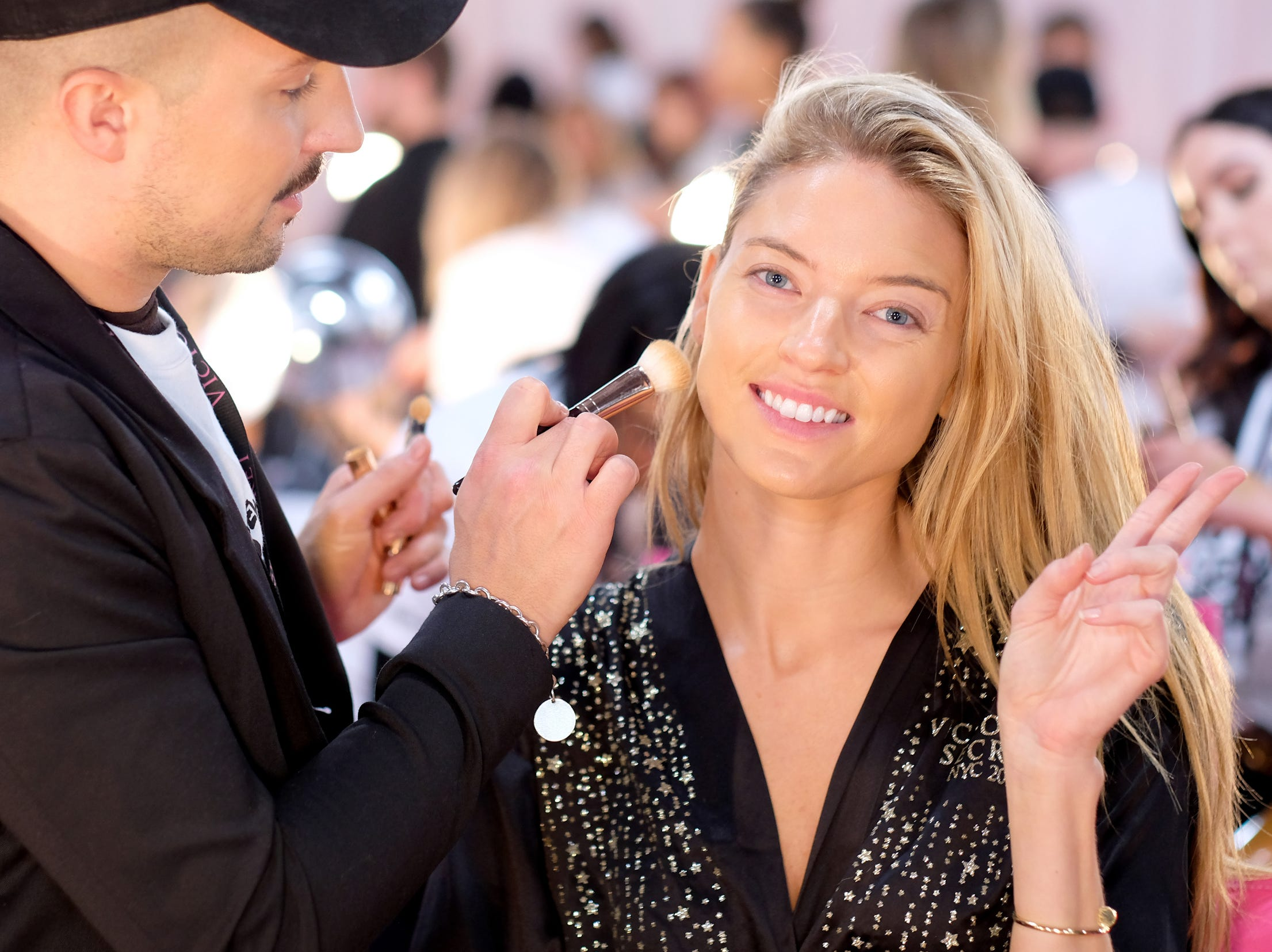 It's make-up time for Angel Martha Hunt.