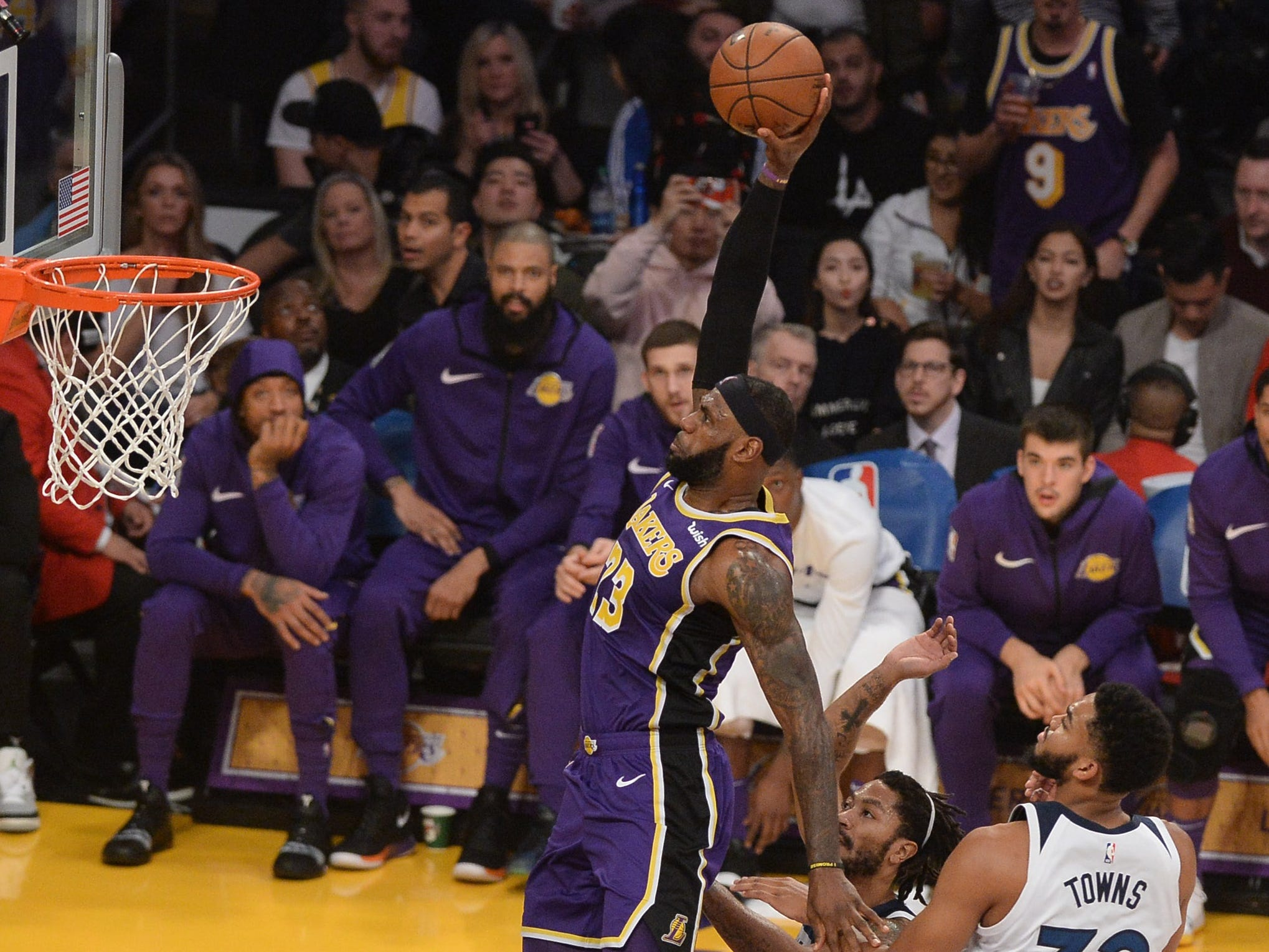 Nov. 7: Lakers forward LeBron James glides through the lane for a one-handed slam during the first half against the T'wolves.