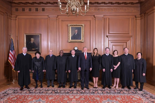President Donald Trump and first lady Melania Trump pose with Supreme Court justices prior to Brett Kavanaugh's investiture ceremony Nov. 8, 2018, in Washington, D.C. Kavanaugh's wife, Ashley, stands to the right of him.