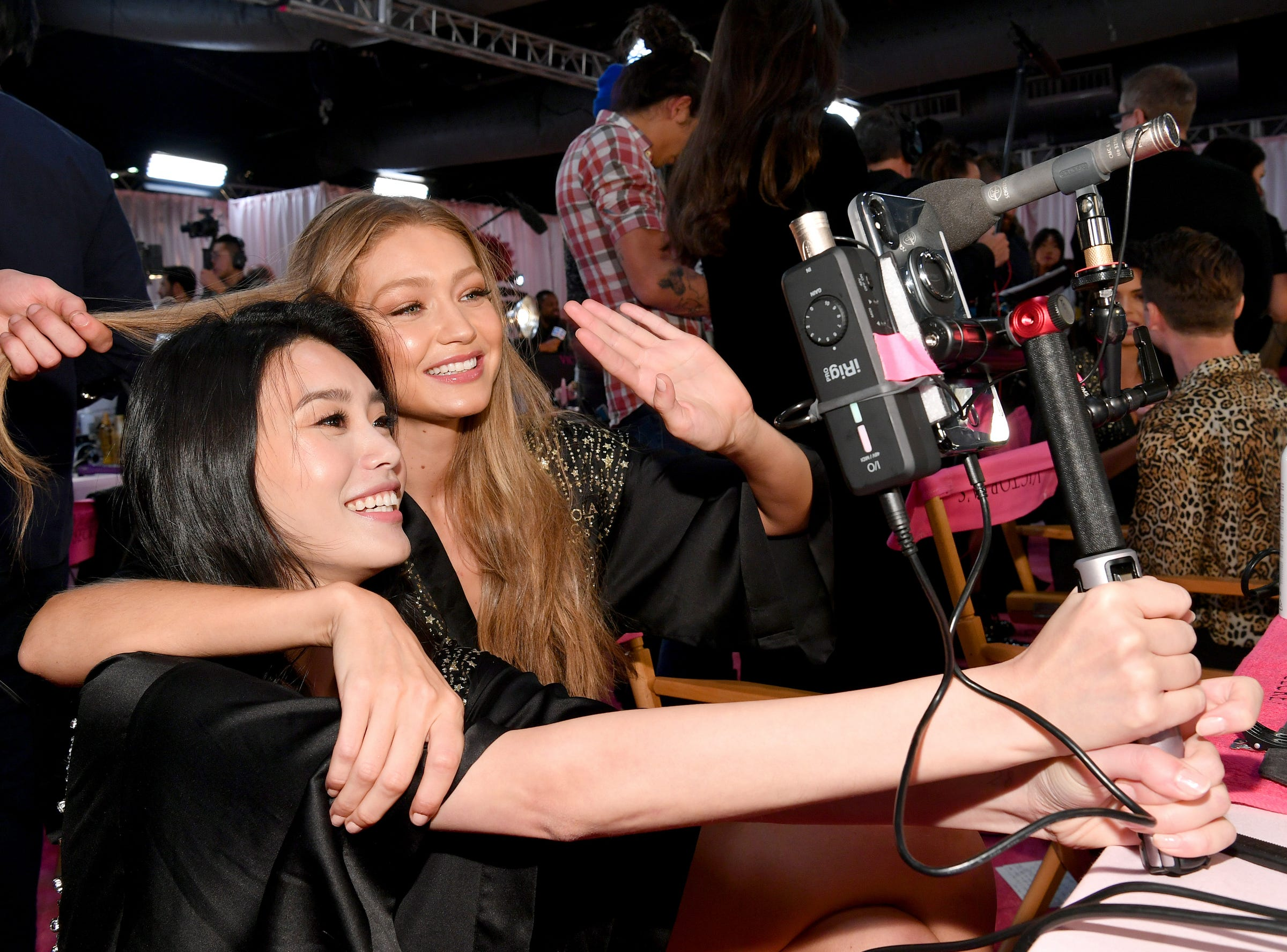 Ming Xi works a video rig with Gigi Hadid, right, as the  prep for the Victoria's Secret Fashion Show 2018.