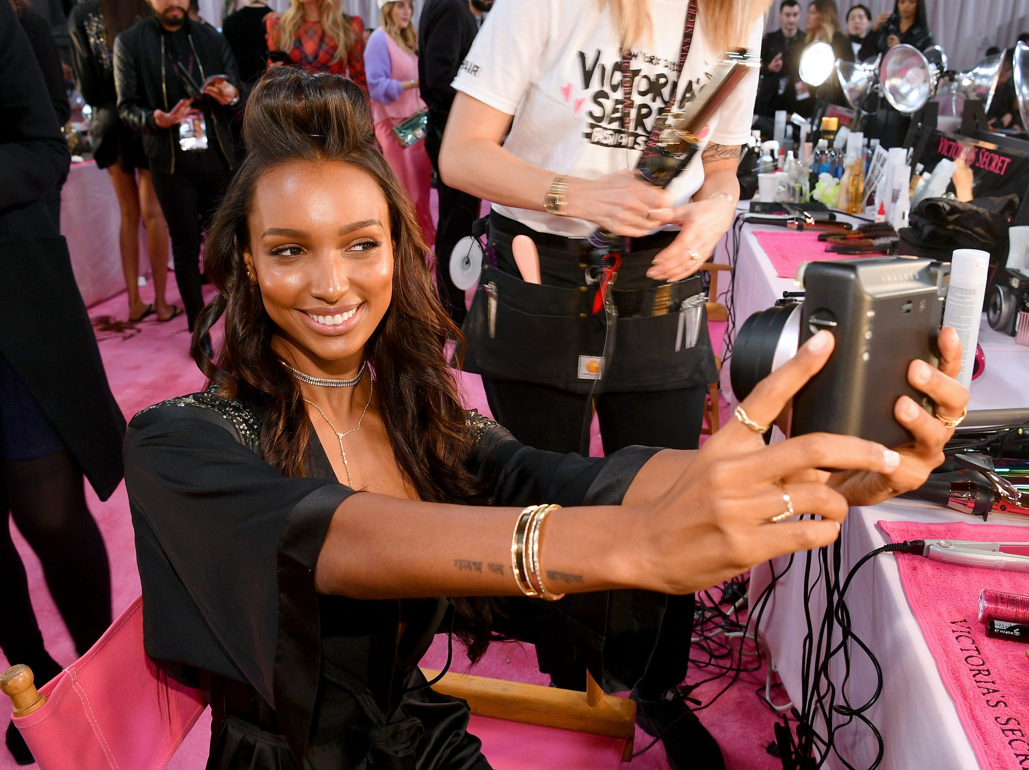 Cheese! Agel  Jasmine Tookes poses with a Fujifilm Instax camera.