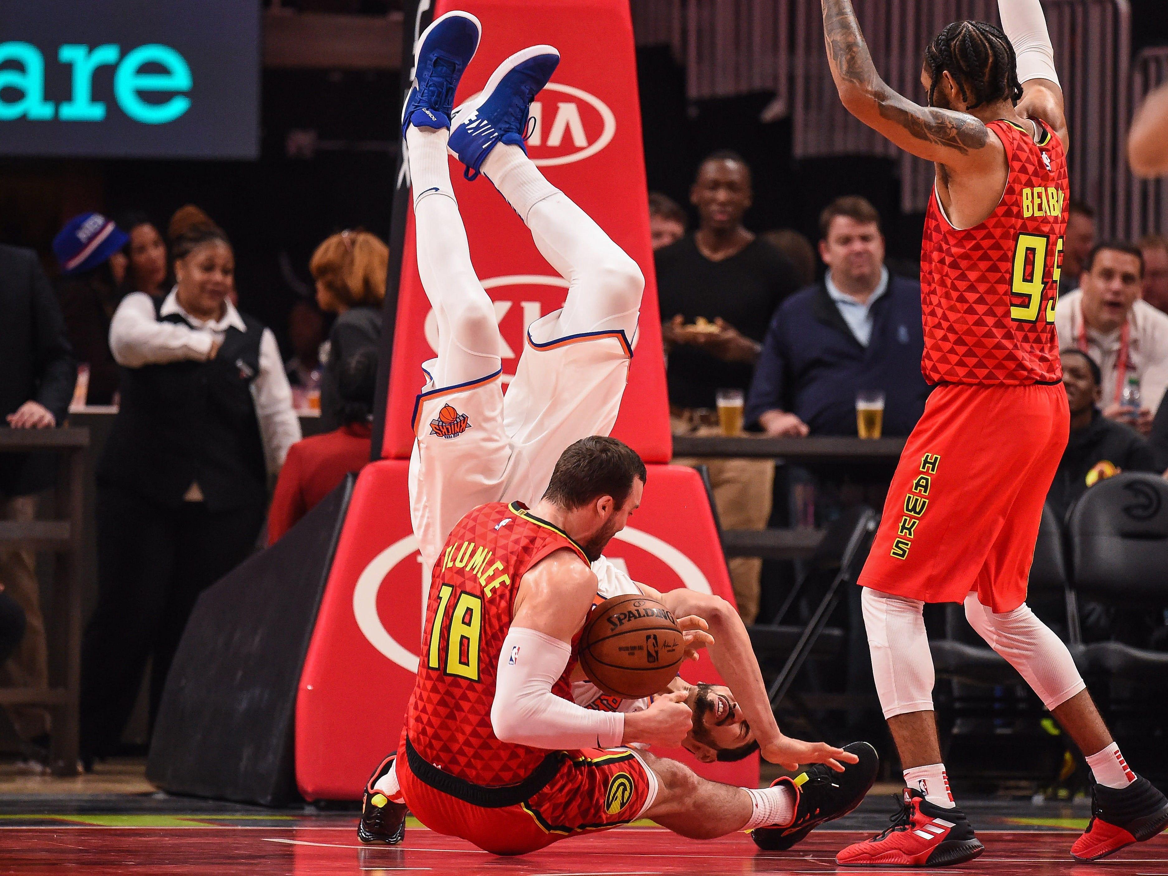 Nov. 7: Knicks center Enes Kanter (00) flips over Hawks center Miles Plumlee (18) during a second-half scramble for the ball in Atlanta.