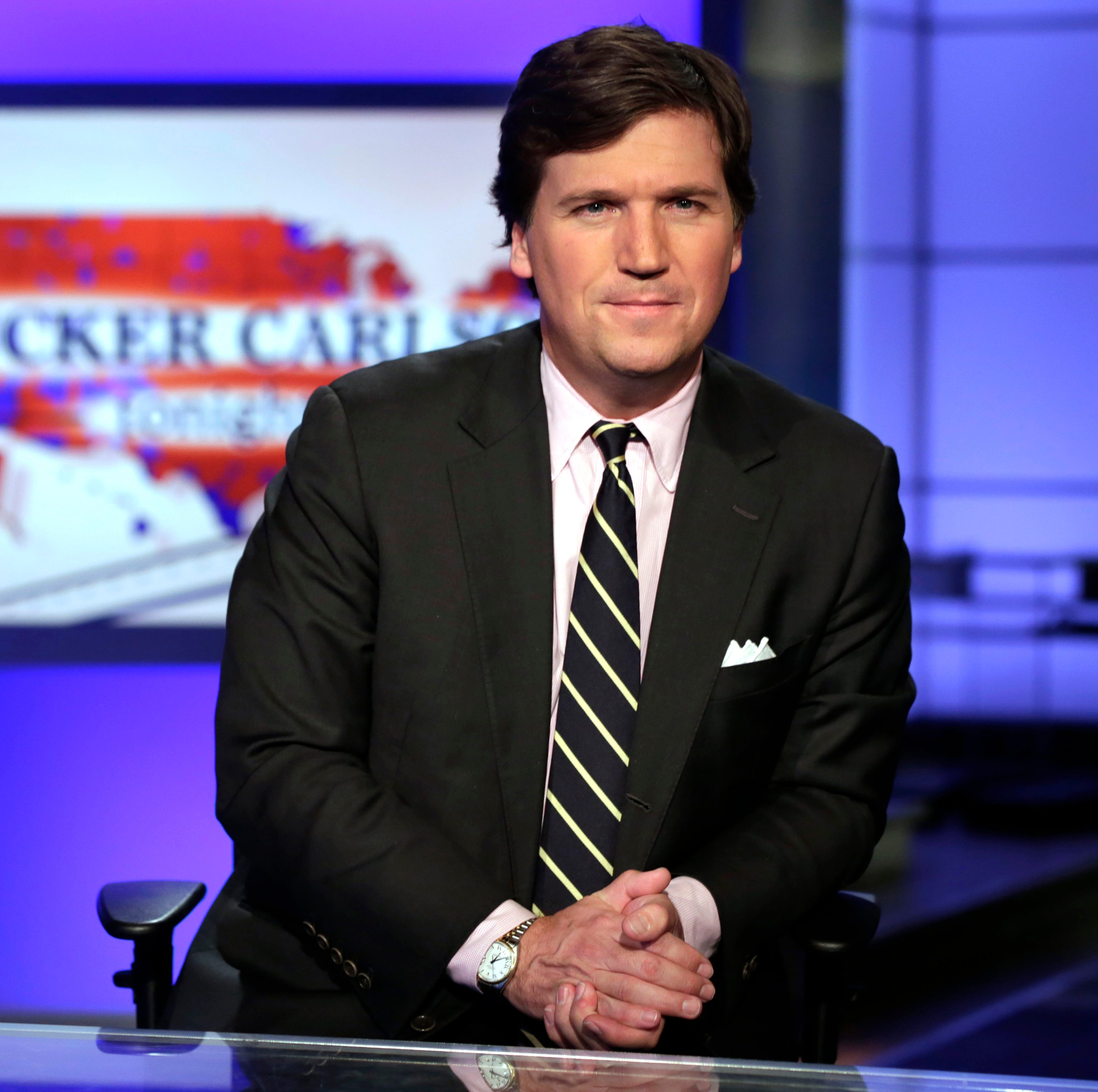 "In this March 2, 2017 file photo, Tucker Carlson, host of ""Tucker Carlson Tonight,"" poses for photos in a Fox News Channel studio, in New York."