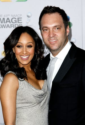 Tamera Mowry-Housley and Adam Housley in 2012.
