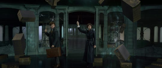 """Newt (Eddie Redmayne) and Tina (Katherine Waterston) wave their wands for a spell in the new """"Fantastic Beasts."""""""