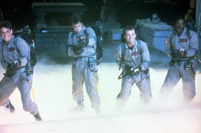 """Harold Ramis, left, Dan Aykroyd, Bill Murray and Ernie Hudson in a scene from the 1984 motion picture """"Ghostbusters."""""""