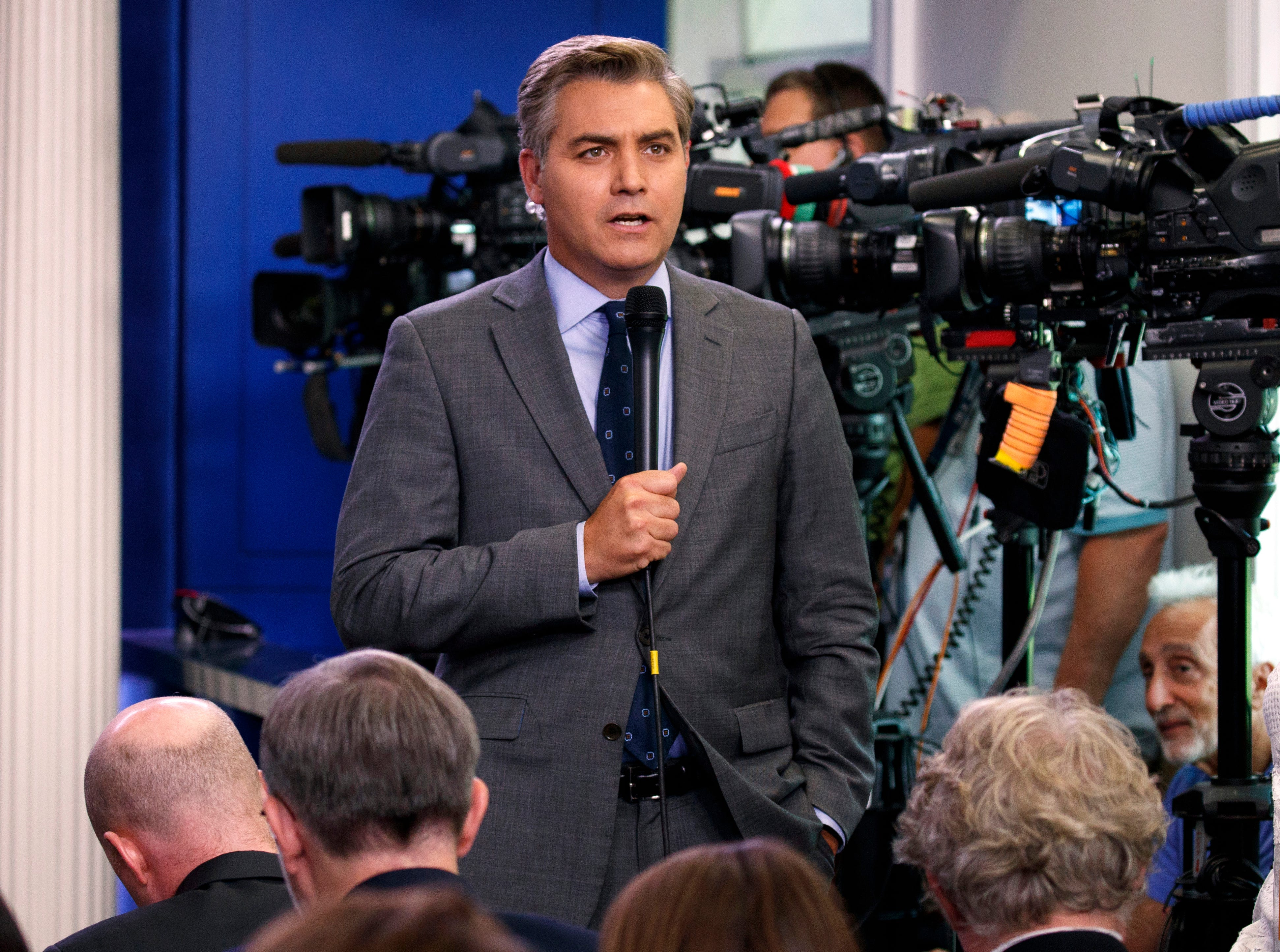 CNN's Jim Acosta has White House press badge revoked after Trump called him 'terrible'