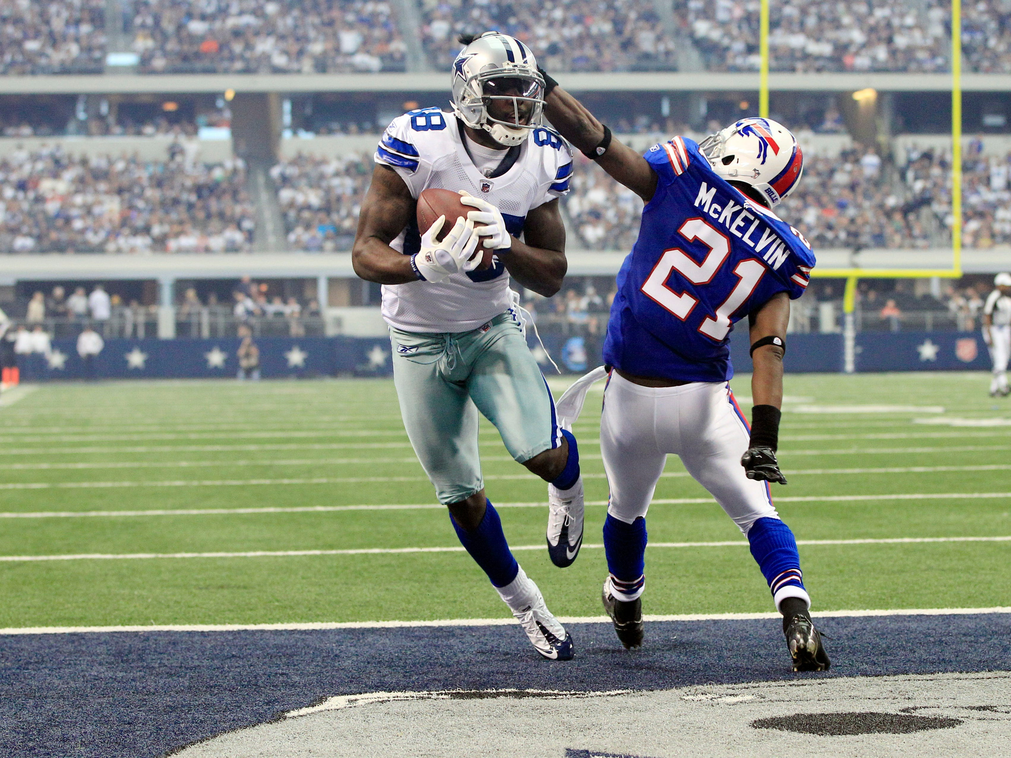 Dez Bryant makes a touchdown reception as Buffalo Bills' Leodis McKelvin defends in 2011.