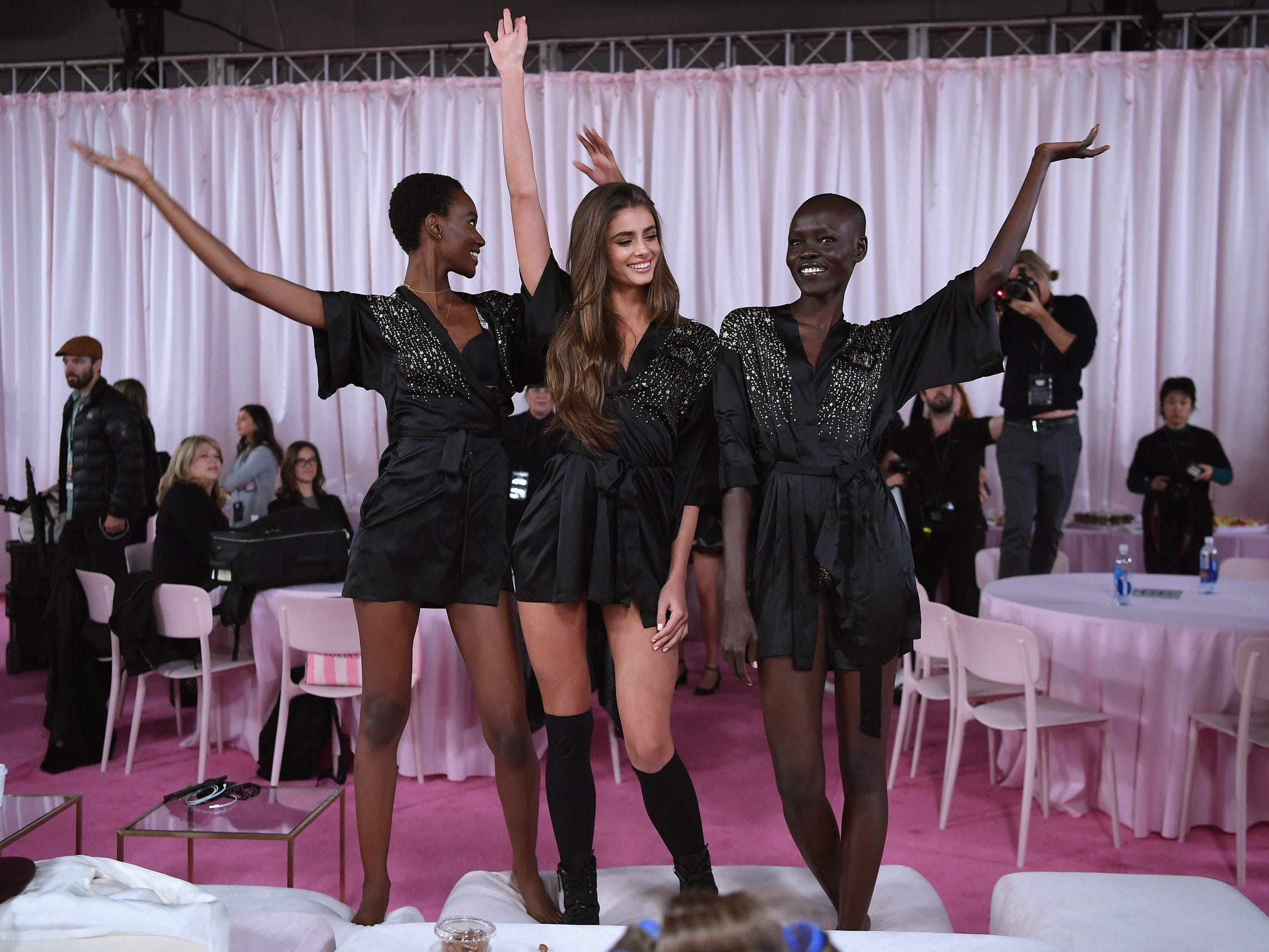 Ta-da! Tanzanian model Herieth Paul, US model Taylor Hill and South Sudanese model Grace Bol work their craft.