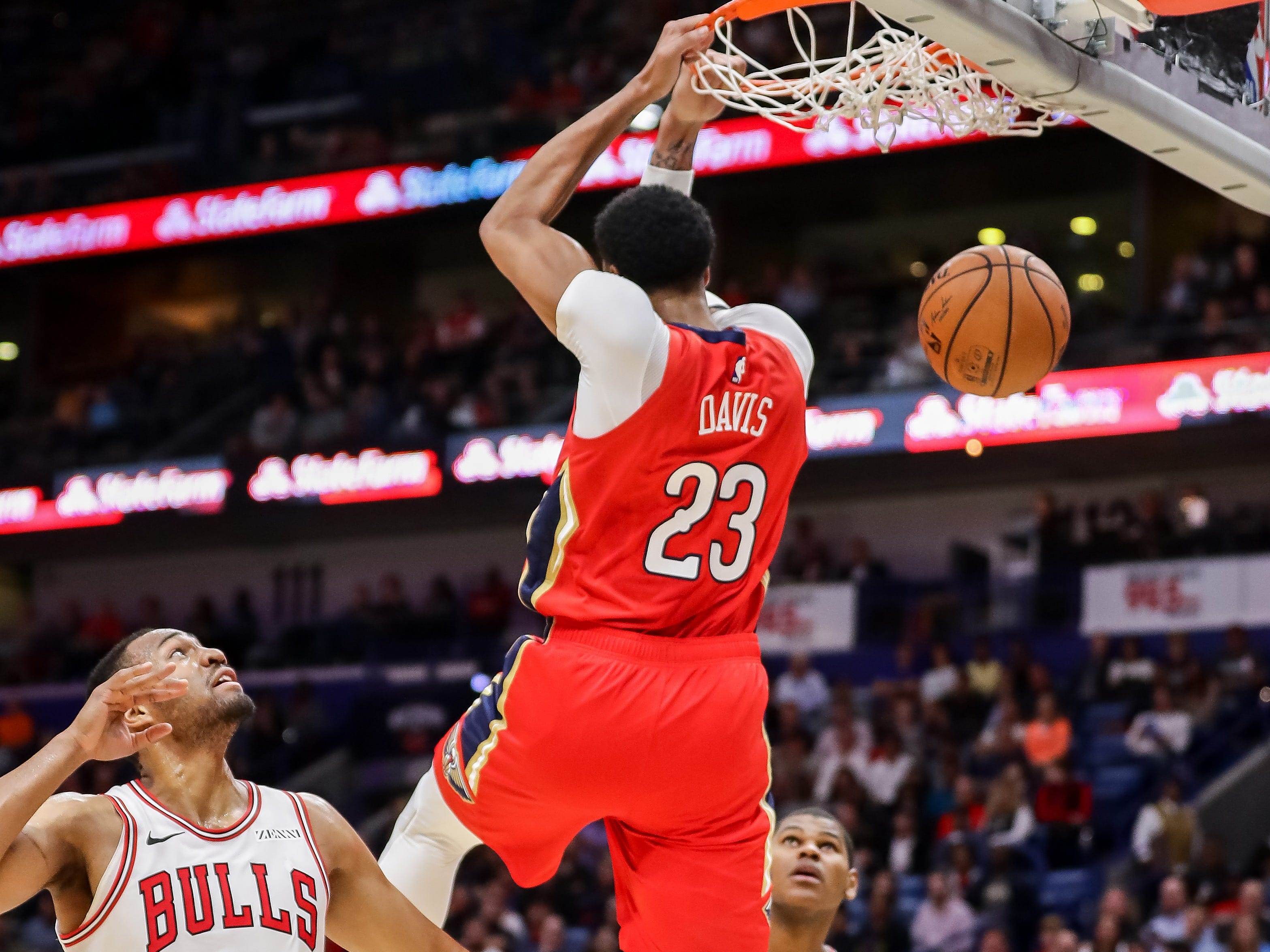 Nov. 7: Pelicans forward Anthony Davis finishes off a reverse alley-oop with a two-handed flush during the first half against the Bulls in New Orleans.