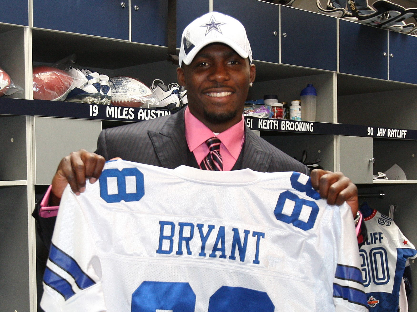 Dez Bryant holds his jersey (88) in the lockerroom at Dallas Cowboys headquarters after being selected in the 2010 NFL draft.