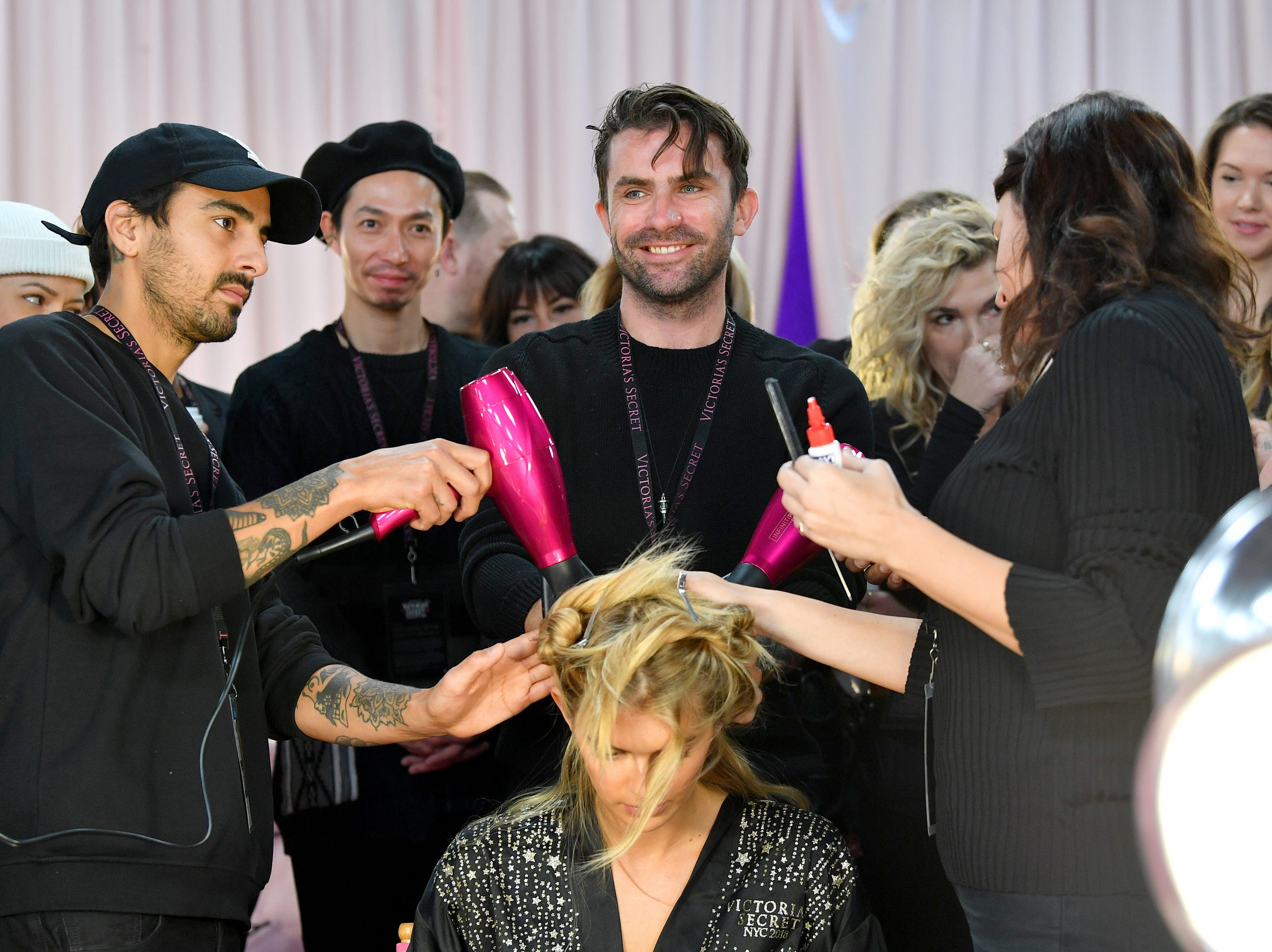 Lead Hairstylist Anthony Turner, center,  prepares Angels backstage.