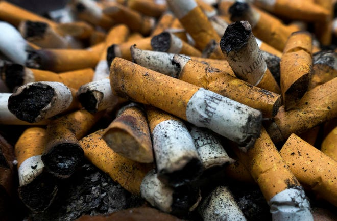(FILES) In this file photo taken on April 18, 2016 smoked cigarettes are seen in an ashtray in Centreville, Virginia.