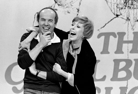 In this March 19, 1978 photo, Carol Burnett shares a laugh with Tim Conway during taping of her final show, in Los Angeles.