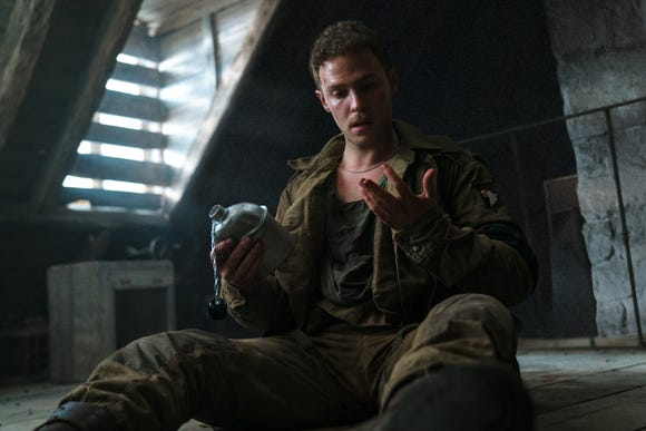 "Iain De Caestecker co-stars as war photographer Chase in ""Overlord."""