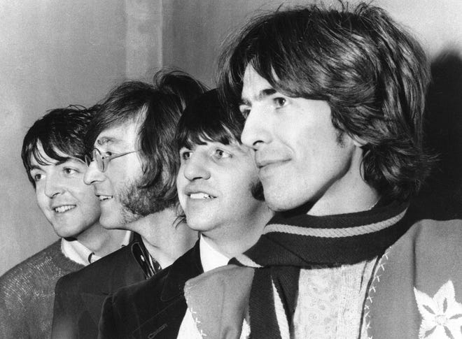 "This Feb. 28, 1968 file photo shows The Beatles, from left, Paul McCartney, John Lennon, Ringo Starr and George Harrison. The Beatles have released a new music video on Apple Music for their 1968 song, ""Glass Onion."" The video was released Tuesday and features rare photos and performance footage. The song appeared on their self-titled ninth album, often referred to as the ""White Album,"" which celebrates its 50th anniversary this year."
