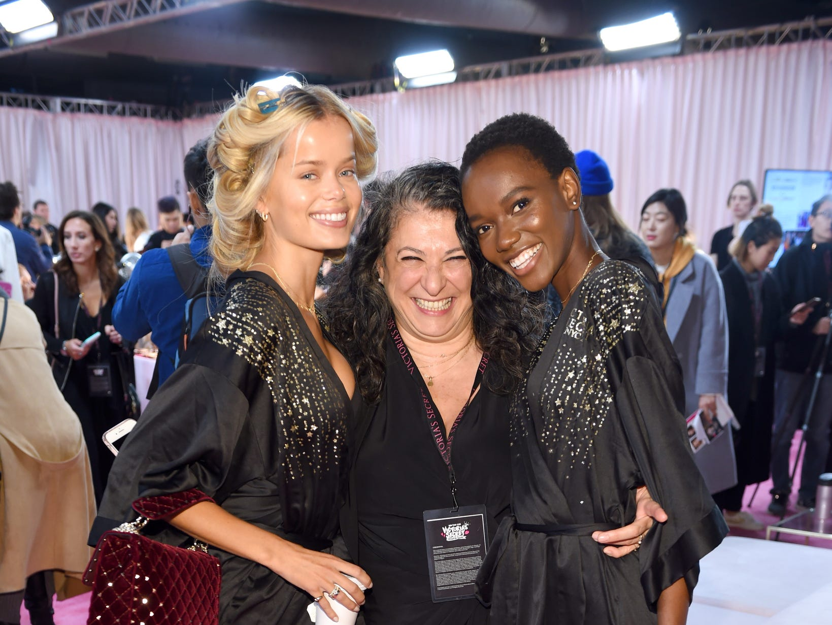 Frida Aasen, left, Sophia Neophitou and Herieth Paul get close backstage.