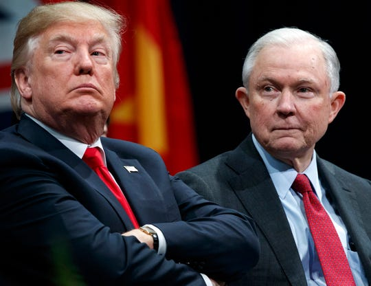President Donald Trump is pictured with Jeff Sessions during the FBI National Academy graduation ceremony in Quantico, Virginia.