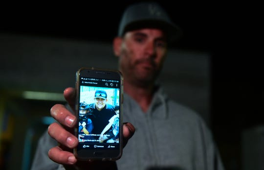 Jason Coffman displays a photo of his son Cody outside the Thousand Oaks Teen Center. He came there hoping to find Cody, who was at the Borderline Bar and Grill in Thousand Oaks, Calif., on Nov. 8, 2018.