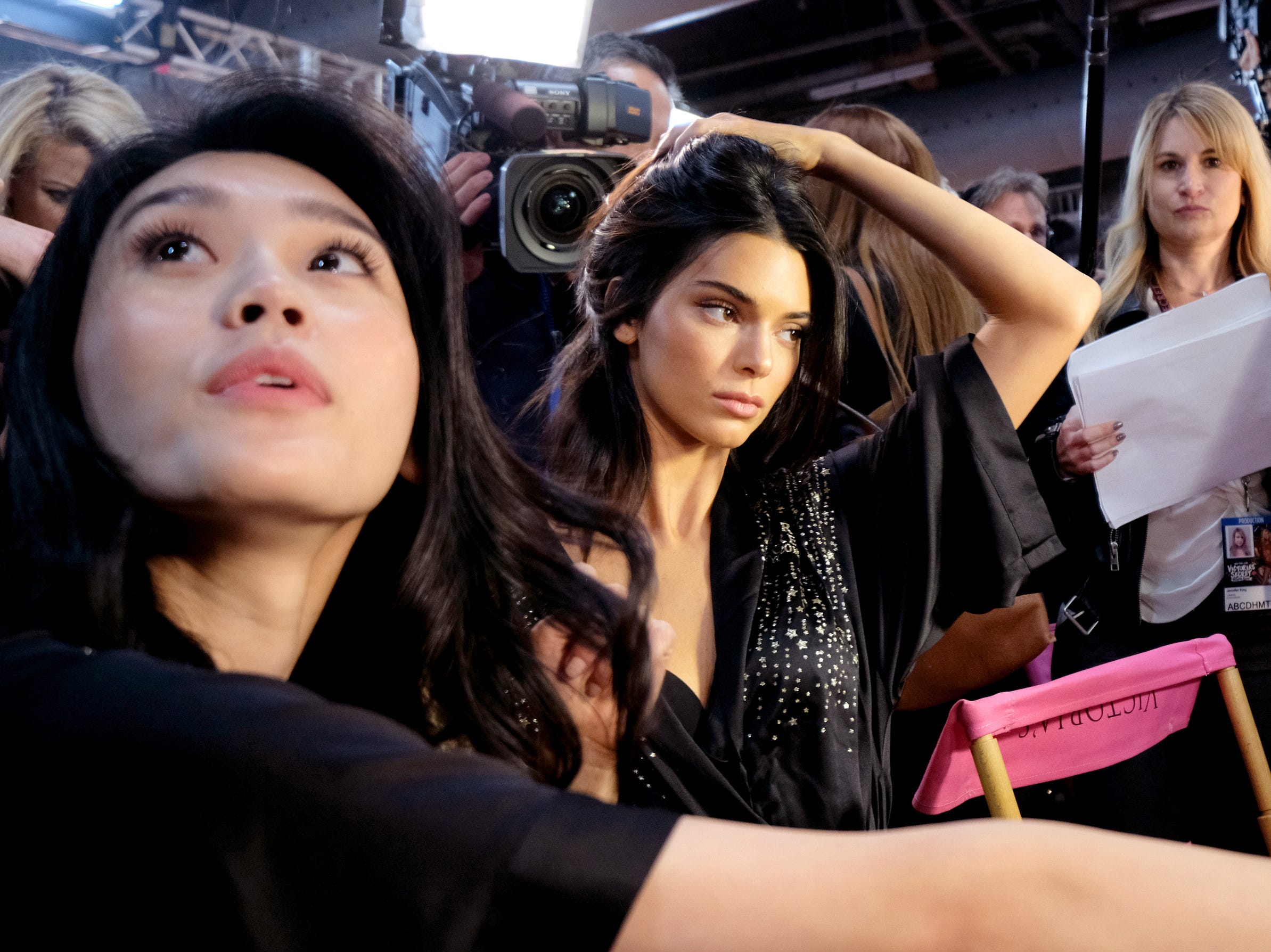 Ming Xi, left,  and Kendall Jenner prepare backstage at the Victoria's Secret Fashion Show.