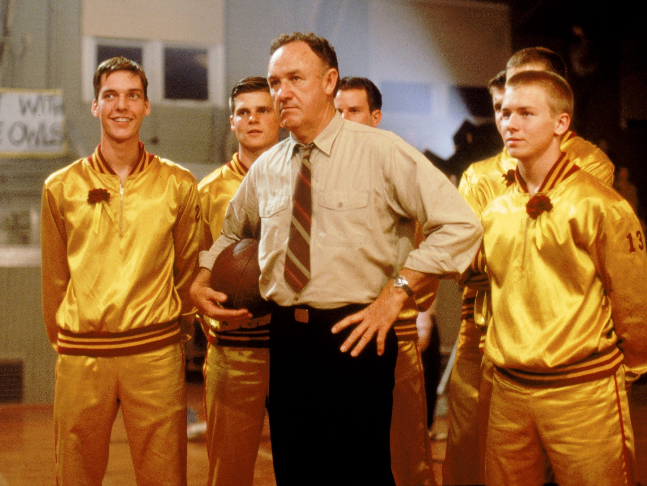 "Gene Hackman, center, with Hickory Team Members in a scene from Orion Pictures' ""Hoosiers."" --- DATE TAKEN: recd 1986  No Byline   Orion Pictures Corporation , Source: Orion Pictures Corporation       HO      - handout   ORG XMIT: ZX15106"