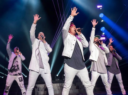 Backstreet Boys members Brian Littrell, left, Kevin Richardson, Nick Carter, AJ McLean and Howie Dorough perform in Wantagh, New York, in July. Their Las Vegas residency concludes in April, ahead of a massive world tour.