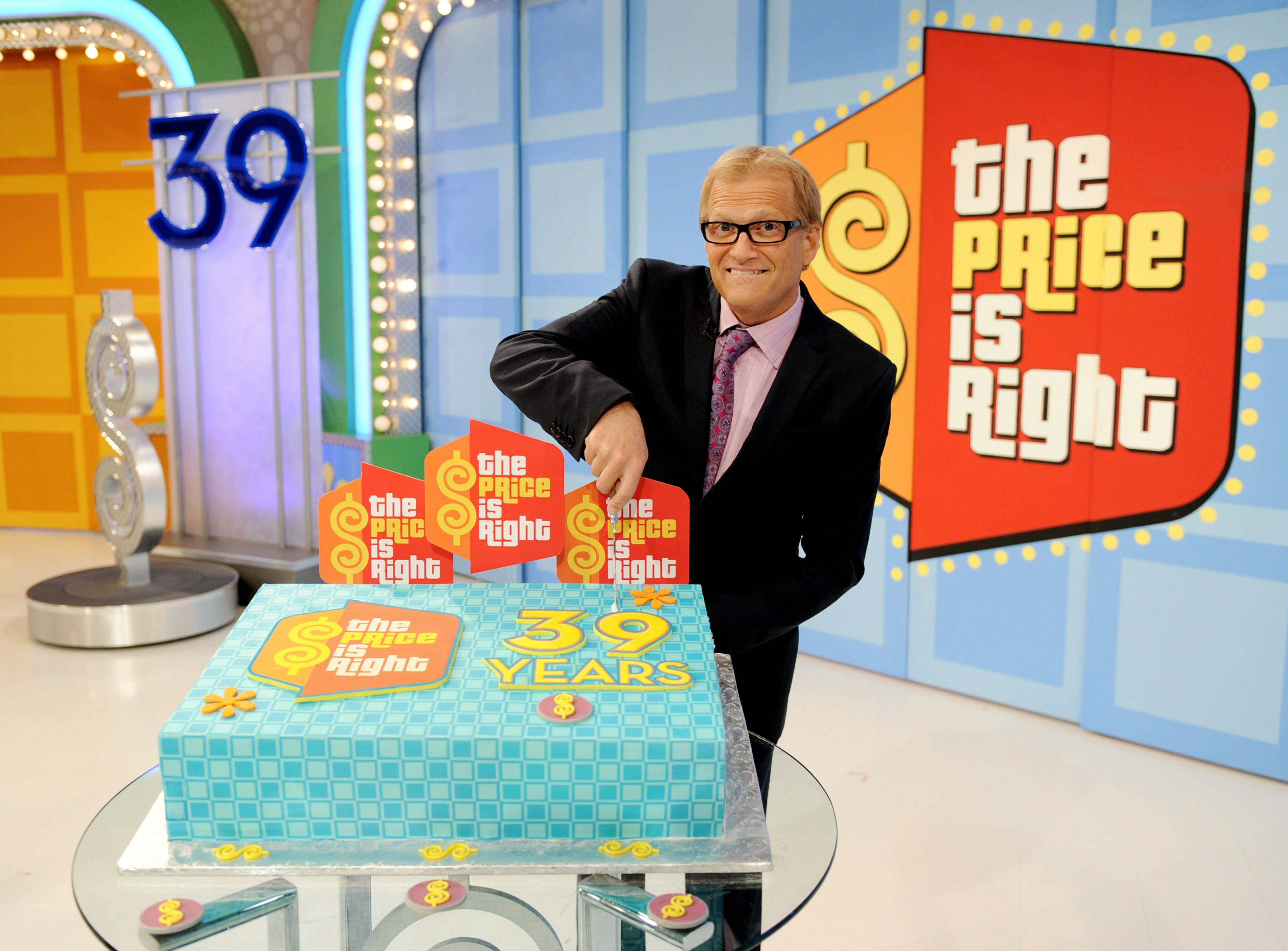 "ORG XMIT: 103117041 LOS ANGELES, CA - AUGUST 09:  Comedian/host Drew Carey appears onstage at the taping of the 39th season premiere of ""The Price is Right"" at Television City on August 9, 2010 in Los Angeles, California.  (Photo by Kevin Winter/Getty Images) GTY ID: 117041KW004_39th_Season_"