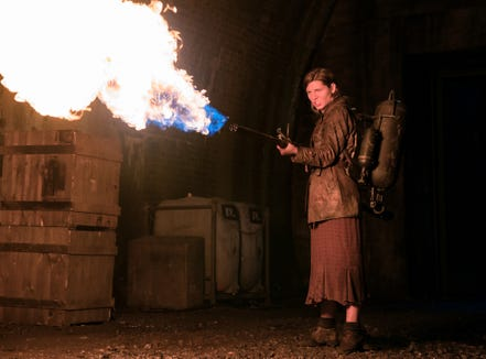 """Chloe (Mathilde Ollivier) takes flamethrower to a zombie in """"Overlord."""""""
