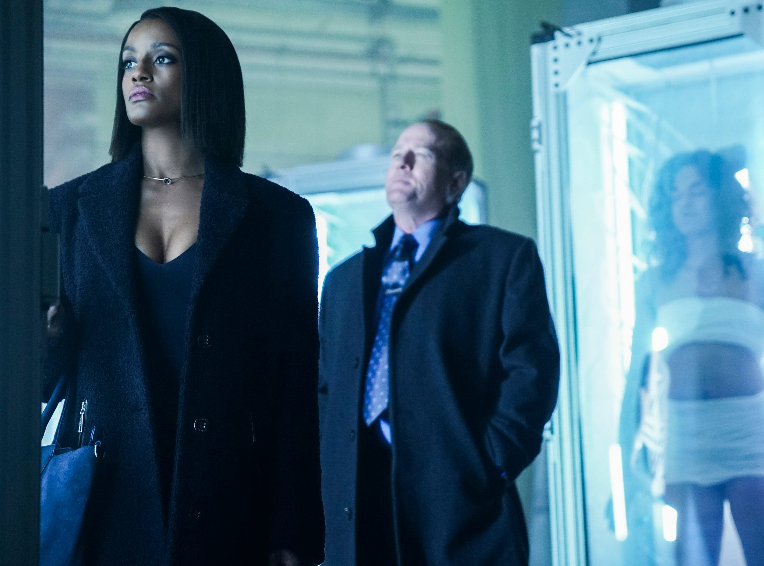 "Black Lightning -- ""Sins Of The Father: The Book of Redemption -- Image BLK110b_0088bb â€"" Pictured: Skye P. Marshall as Ms.Fowdy and Gregg Henry as Martin Proctor -- Photo: Annette Brown/The CW -- © 2018 The CW Network, LLC. All rights reserved."