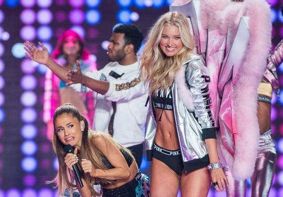 Ariana Grande dodges Elsa Hosk on the Victoria's Secret runway in 2014.