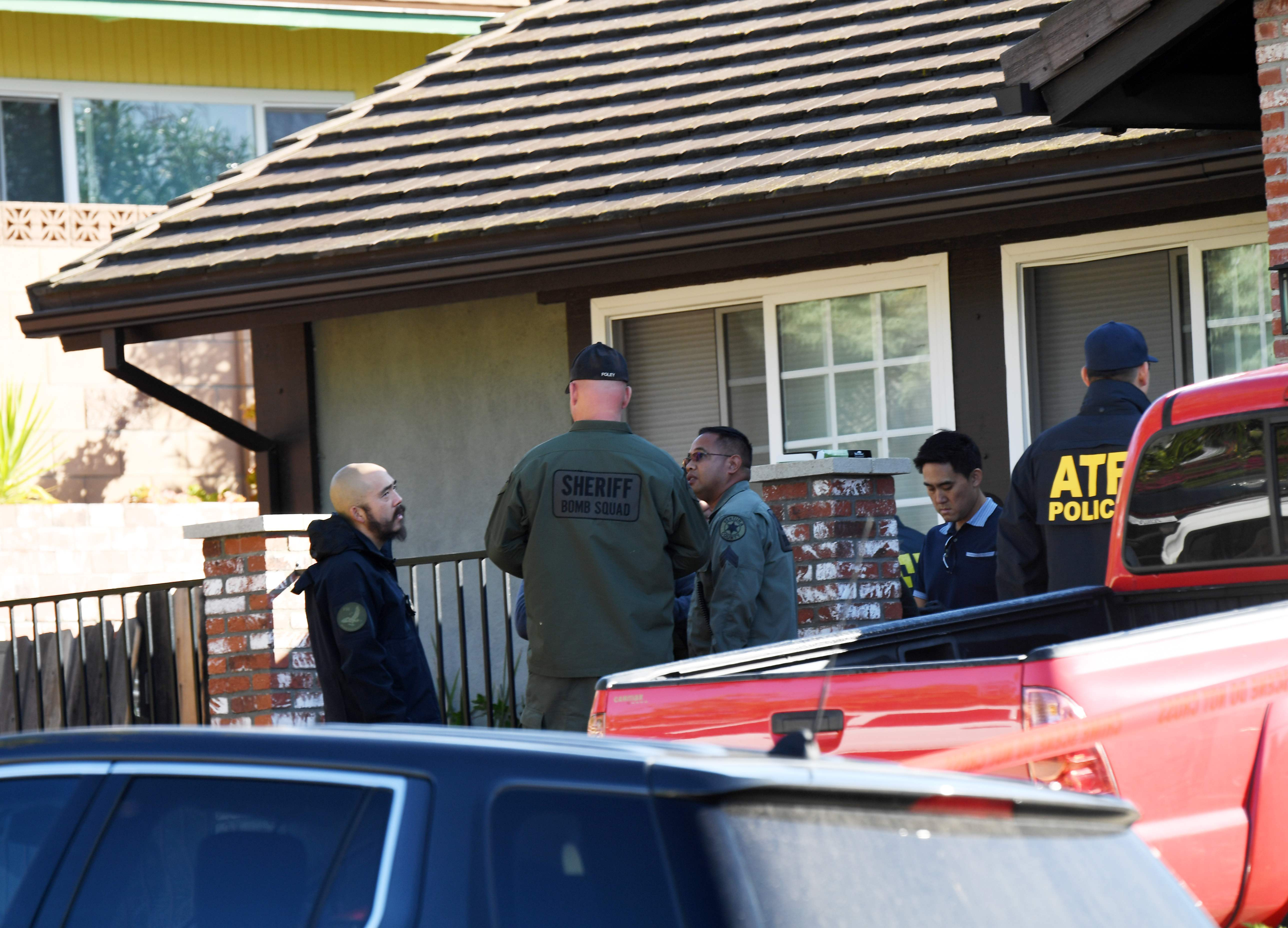 The home of Ian David Long is searched on Thursday in Thousand Oaks, California.