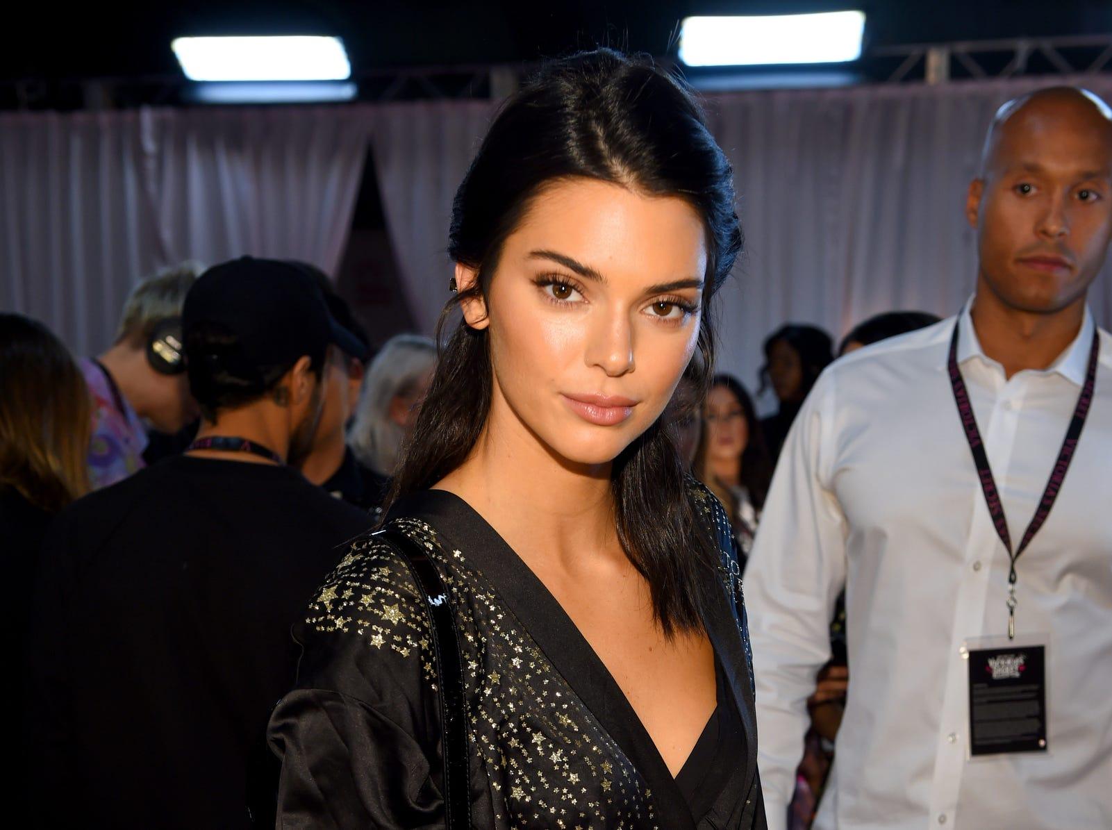 Angel Kendall Jenner prepares backstage.