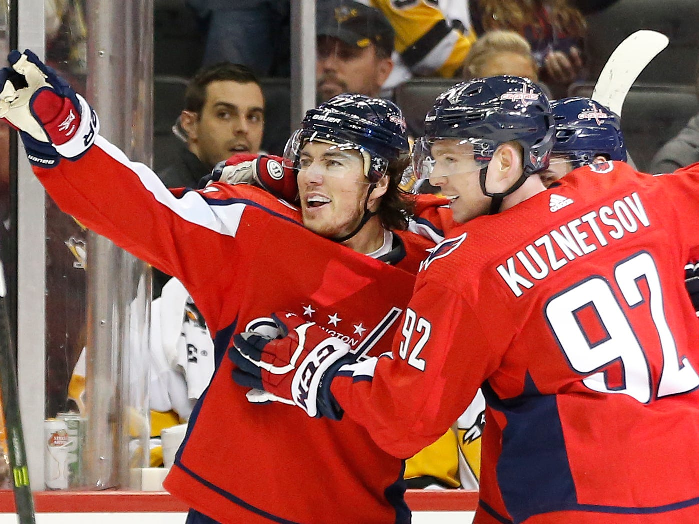 Nov. 7: Washington Capitals winger T.J. Oshie, left, celebrates with teammates after scoring the winning goal against the Pittsburgh Penguins.
