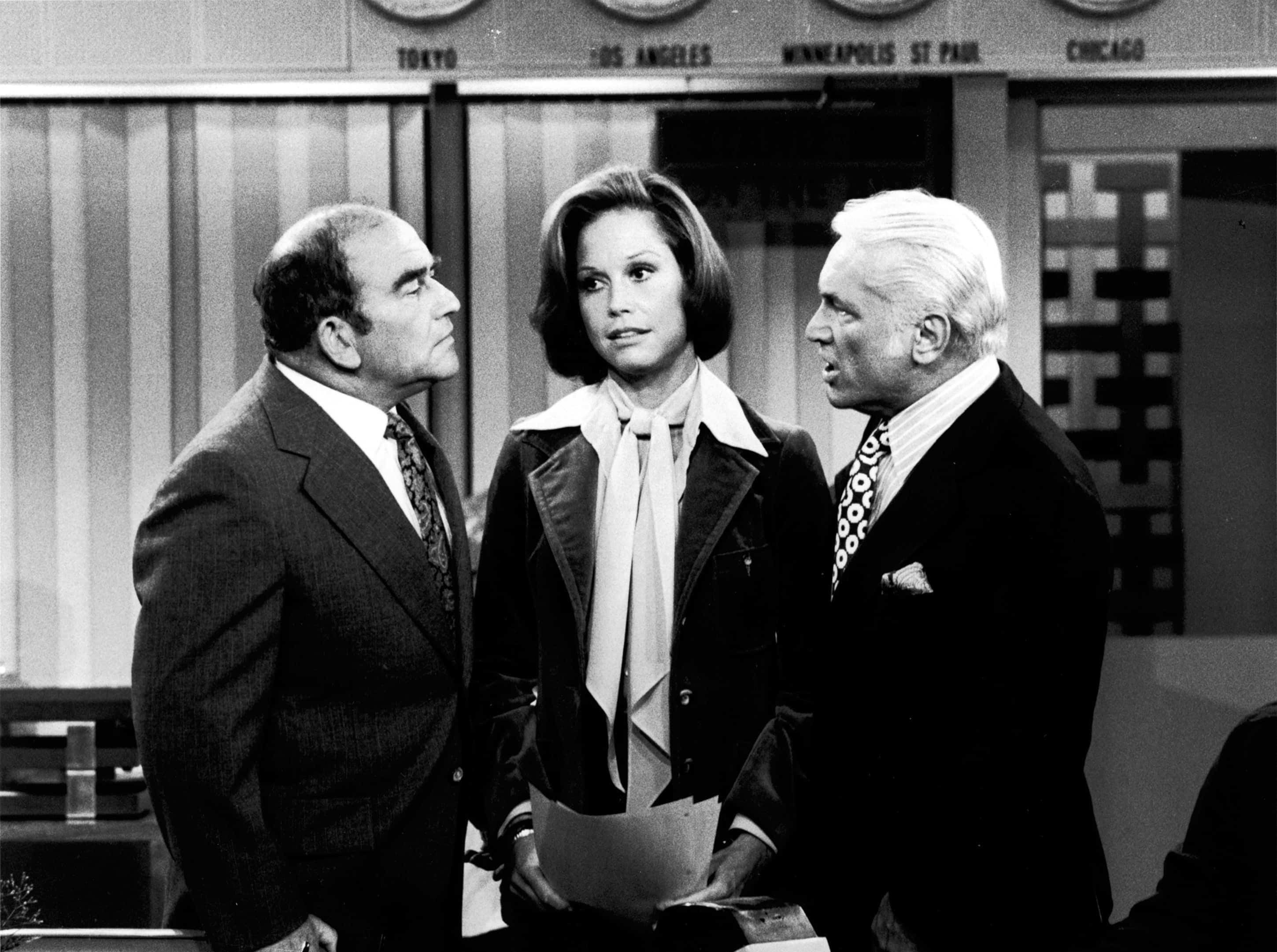 "Edward Asner, left, Mary Tyler Moore and Ted Knight appear in a scene from the 1970s comedy, ""The Mary Tyler Moore Show."""
