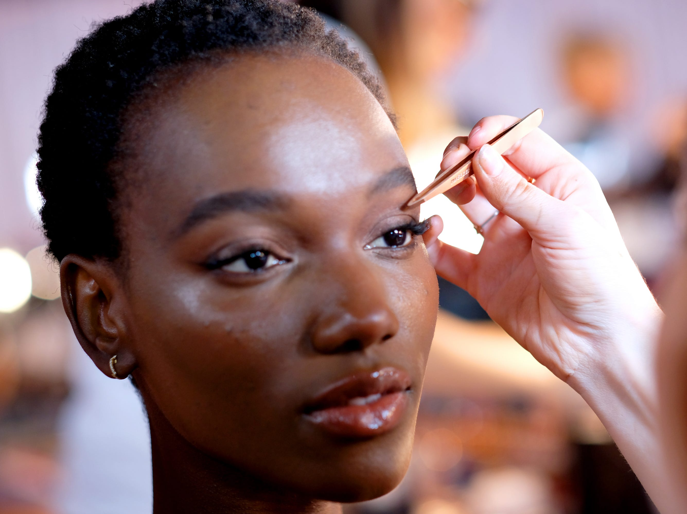 Herieth Paul gets her face prep backstage.