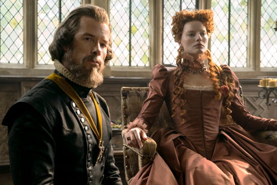 "Guy Pearce stars as William Cecil and Margot Robbie as Queen Elizabeth I in ""Mary Queen of Scots."""