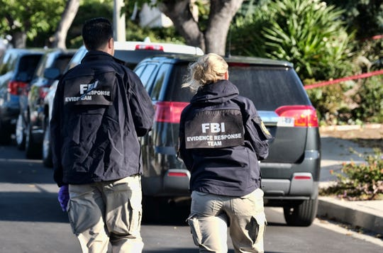 FBI investigators arrive outside the house of shooting suspect David Ian Long in Newbury Park, California, on Thursday, Nov. 8, 2018.