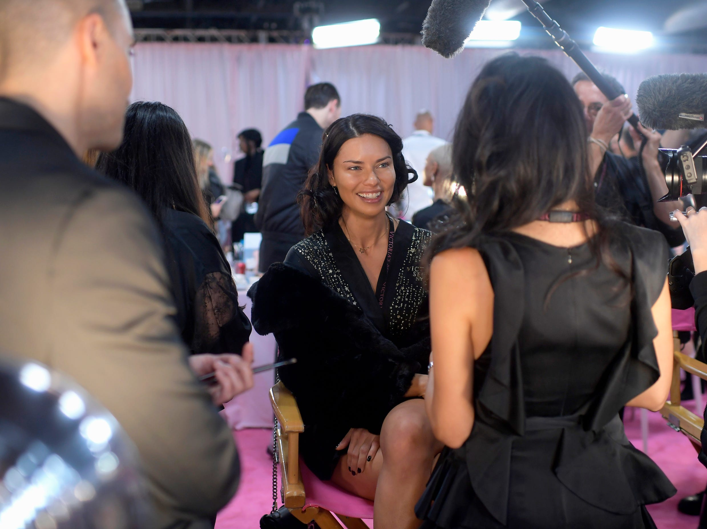 Veteran Victoria's Secret Angel Adriana Lima takes media questions backstage.