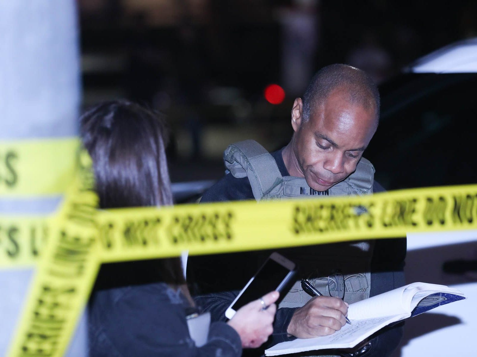 Investigators work at the scene of a mass shooting at the Borderline Bar and Grill in Thousand Oaks, Calif., Nov. 8, 2018.