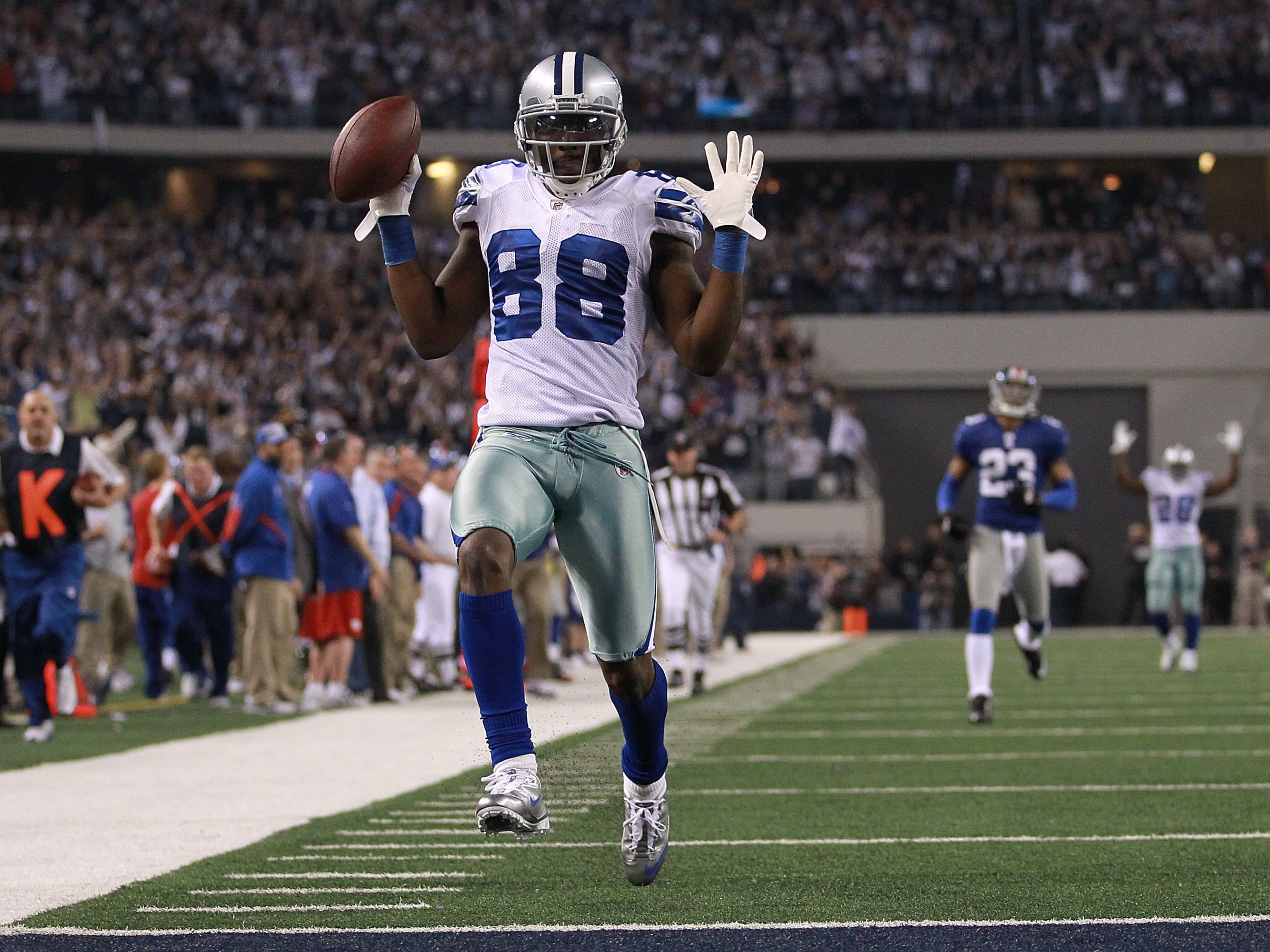 Dez Bryant scores a touchdown against the New York Giants at Cowboys Stadium in 2011.