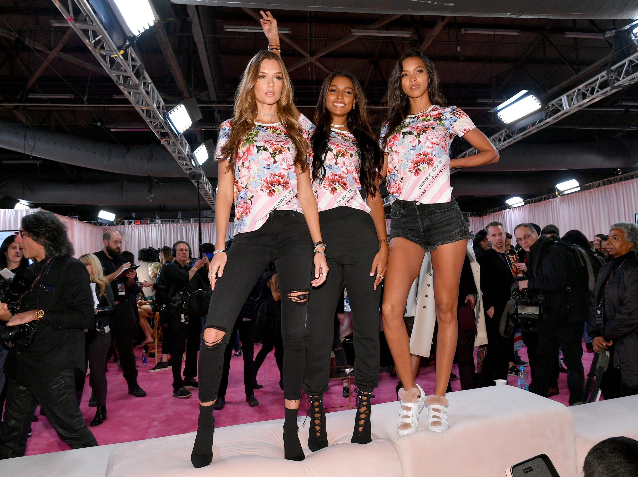 Angels Lais Ribeiro, left, Jasmine Tookes and Josephine Skriver pose wearing Mary Katrantzou T-Shirts backstage.