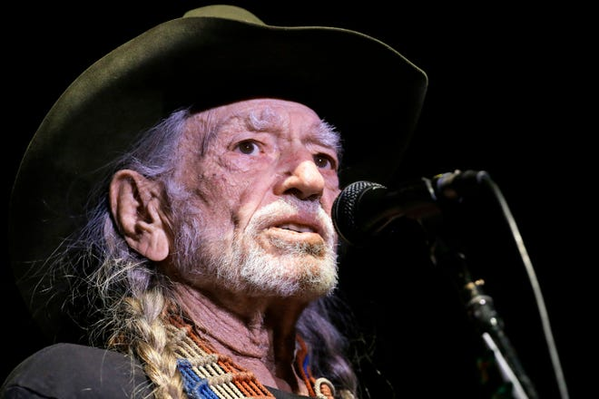 FILE - In this Jan. 7, 2017, file photo, Willie Nelson performs in Nashville, Tenn. The Recording Academy's Producers & Engineers Wing will honor Nelson days before the 2019 Grammy Awards. The academy announced Tuesday, Oct. 30, 2018, that Nelson's career and achievements will be celebrated on Feb. 6, 2019 at The Village Studios in Los Angeles. (AP Photo/Mark Humphrey, File) ORG XMIT: NYET200