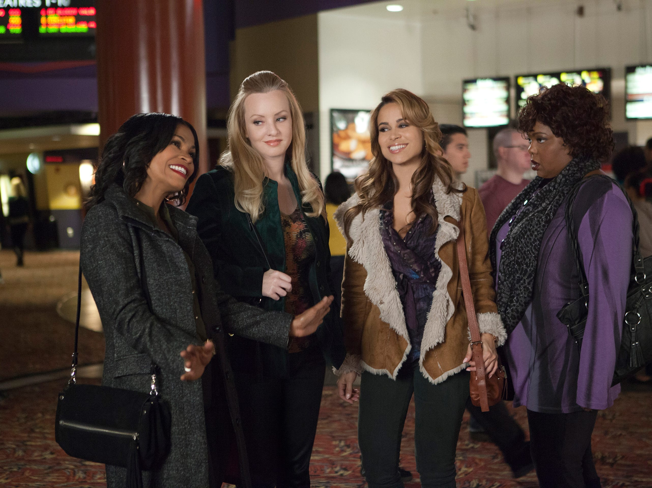 "Nia Long, left, Wendi McLendon-Covey, Zulay Henao, and Cocoa Brown in a scene from the motion picture ""The Single Moms Club."" Credit: K C Bailey, Lionsgate [Via MerlinFTP Drop]"