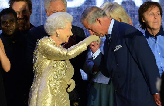 Prince Charles kisses the hand of his mother, Queen Elizabeth II, after her Diamond Jubilee concert at Buckingham Palace on June 4, 2012.